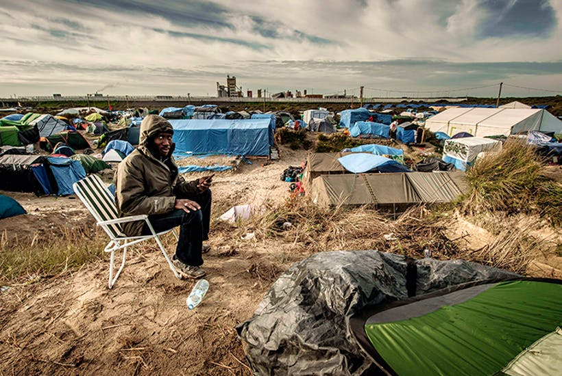 A sudanese immigrant in the infamous Calais Jungle before it was razed last year. Click to enlarge