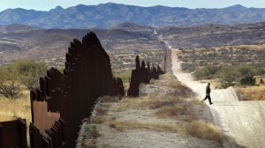 An illegal migrant crosses the border between Mexico and the US. Click to enlarge