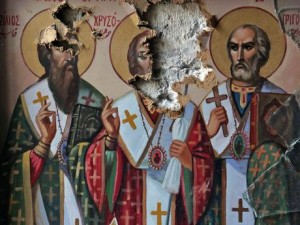 Damaged icons in a Strian Christian church. Click to enlarge