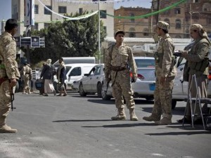 Houthi Shiite soldiers stand guard on a street leading to the presidential palace in Sanaa. Click to enlarge