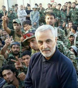 IRGC commander Gen Soleimani pictured in Syria recently with Iraqi Shia fighters near Aleppo. Click to enlarge