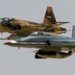 An Iranian twin-seat F-5F Tiger II flies in formation with an F-5-derived Saeghe combat aircraft (foreground). The two types can be distinguished in this picture by the twin-fin V-tail arrangement of the latter type. Source: Iran state media. Click to enlarge