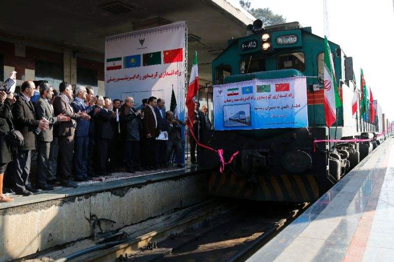 Iranian officials applaud as first train connecting China and Iran pulls into Tehran station in Feb. 2016. Click to enlarge