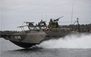 Swedish naval vessel searches the waters near Stockholm for the source of uinderwater radio signals. Click to enlarge