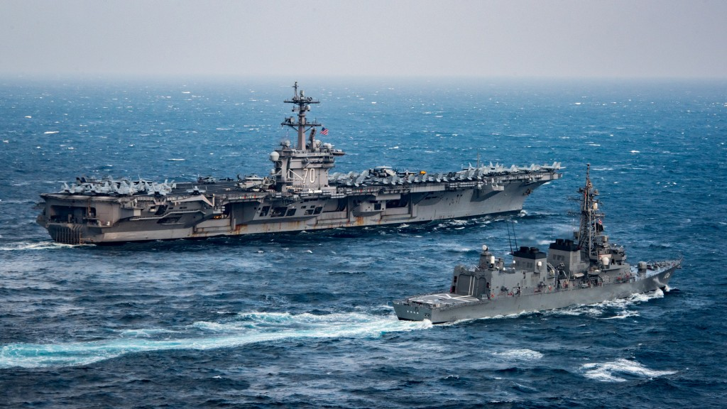 USS Carl Vinson (background) in the East China Sea with Japanese destroyer JS Samidare. Click to enlarge
