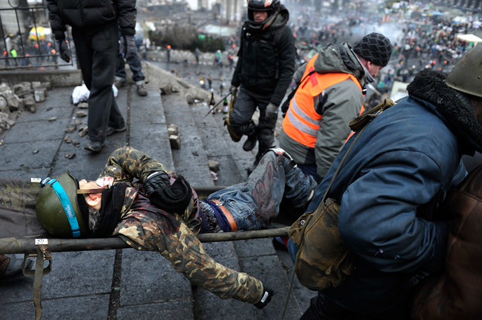 Wounded demonstrator in Independent square, dubbed Maidan, in Kiev. Click to enlarge
