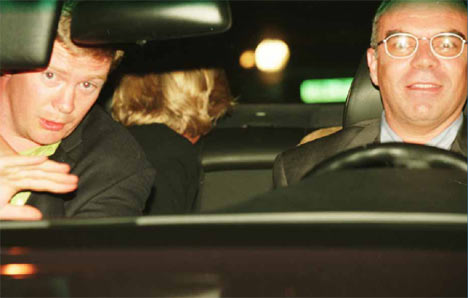 Princess Diana looks back at pursuing paparazzi as Henri Paul (right) drives on to her fatal crash. Click to enlarge