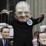 Protesters masquarading as Murdoch manipulate puppets representing David Cameron and former Culture Secretary Jeremy-Hunt. Click to enlarge