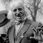 Jimmy Savile sporting his OBE at Buckingham Palace 1972. Many have wondered whether he wasn't 'protected' with his crimes only being revealed after his death. Click to enlarge
