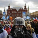 A member of the pro Kremlin youth movement Stal wearing a Darth Vader helmet at a rally for Putin