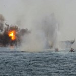 Iranian Revolutionary Guards attack an abandoned warship being used as a target during drills in the Persian Gulf in April, 2011. Click to enlarge