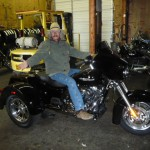 Rense, 66, riding a $30,000 Harley Trike, one of a collection of motorcycles, part of a lifestyle supported by donations from his  readers. Click to enlarge