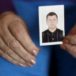 """Two ribs, two Achilles heels, two elbows, two eardrums, two teeth, and so on'' ... a relative holds a picture of Oleksandr Frolov, some of whose body parts were found during a raid by Ukrainian authorities. Click to enlarge"