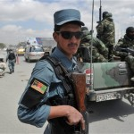 Afghan policeman at a security checkpoint in Kabul. Click to enlarge