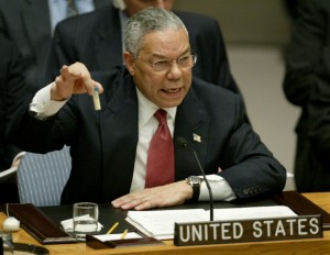 Colin Powell holds up a vial allegedly containing Iraqi anthrax at the UN General Assembly. Click to enlarge