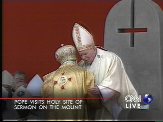 Pope sits before a satanic inverted cross during a visit to Israel in 2000
