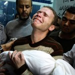 Jihad Masharawi weeps while he holds the body of his 11-month old son Ahmad at Shifa Hospital following an Israeli air strike on their family home in Gaza City, Wednesday, Nov. 14, 2012.