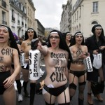 Breast-beating: Femen 'assaulted' by anti-gay marriage demonstrators in Paris