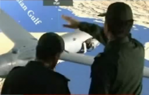 IRGC officers examine ScanEagle drone on Iranian TV.
