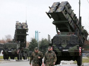 "Soldiers of the Air Defence Missile Squadron 2 walk past Patriot missile launchers in the background in Bad Suelze, northern Germany  on December 4, 2012. Russian President Vladimir Putin warned that any deployment of US-made Patriot missiles on Turkey's volatile border with war-ravaged Syria would exacerbate tensions, and said the two countries had failed to overcome their sharp differences on the conflict. ""Creating additional capabilities on the border does not defuse the situation but on the contrary exacerbates it,"" Putin told a press conference with Turkish Prime Minister Recep Tayyip Erdogan after talks in Istanbul.  AFP PHOTO / BERND WUSTNECK   GERMANY OUT. Click to enlarge"