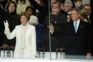 George W. and Laura Bush display the horned god sign