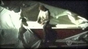 Dzokhar emerges from underneath boat cover during his arrest, apparently uninjured. Click to enlarge