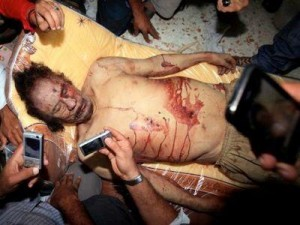 Gaddafi's corpse. Click to enlarge