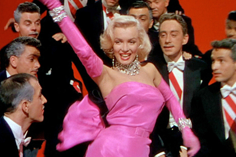 "In the movie ""Gentlemen Prefer Blondes"", Marilyn adorns her trademark platinum blonde ""Hollywood"" hairdo. In this movie, she plays the role of a sensual yet materialistic woman that is not afraid of using her charm to obtain what she wants. This type of character will be repeated time and time again in popular culture."