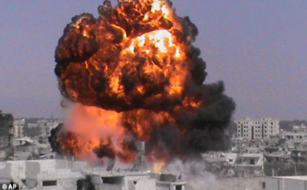 An explosion in the Syrian city of Homs Dec 2012. It has been now been suggested that the U.S. backed the use of chemical weapons to spur international military intervention in Syria. Click to enlarge
