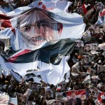 As impoverished crowds gather in support of Mohamed Morsi, the well-heeled march behind their images of the General