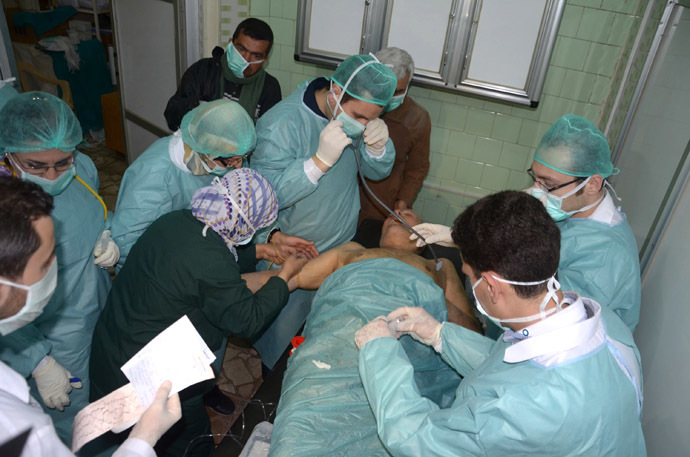 In this image made available by the Syrian News Agency (SANA) on March 19, 2013, medics attend to a man at a hospital in Khan al-Assal in the northern Aleppo province, as  Syria's government accused rebel forces of using chemical weapons for the first time. The opposition denied the claim, saying instead that government forces might have used banned weapons. Click to enlarge