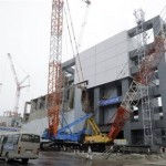 Cover installation for the spent fuel removed from the cooling pool at the No.4 reactor building, Fukushima. Click to enlarge