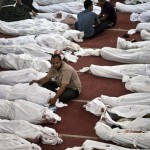 The dead wrapped in shrouds at a Cairo mosque on Aug 15, 2013. Click to enlarge