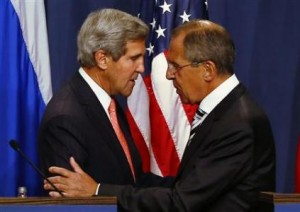US Secretary of State Kerry and Russian Foreign Minister Lavrov shake hands at an earlier news conference in Geneva
