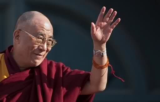 The Dalai Lama: preaching the virtues of poverty while wearing a $60,000 gold watch. Click to enlarge