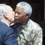 Archive photo of Shimon Peres and Mandela in Johannesburg in 2002. Click to enlarge