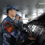 Chinese naval soldiers man their stations aboard the countrys first aircraft carrier Liaoning. Click to enlarge