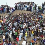 People gather for a memorial service for the 44 miners killed at Marikana mine. Click to enlarge