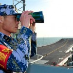 A naval soldier aboard China's first aircraft carrier Liaoning.
