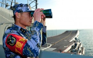 A naval soldier aboard China's first aircraft carrier Liaoning. Click to enlarge