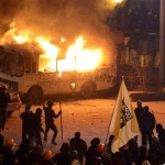 Protesters in front of burning police bus in central Kiev during earlier protests. Click to enlarge