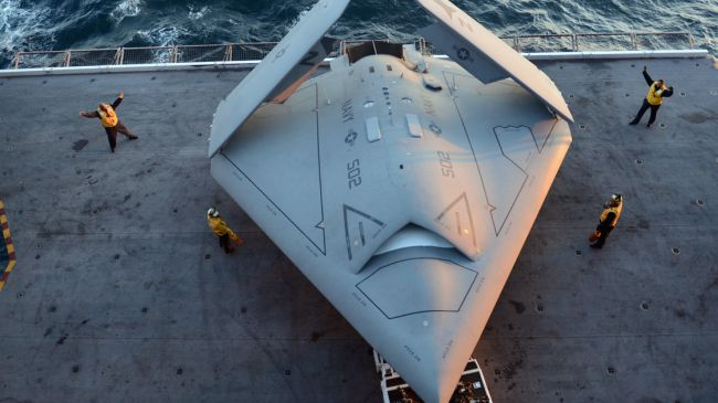 Sailors move an X-47B drone aboard the aircraft carrier U.S.S. George H.W. Bush. Click to enlarge