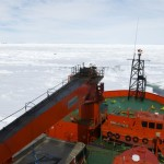 The Snow Dragon icebreaker (left, far background) is seen from the bridge of the Aurora Australis ship off Antarctica. Click to enlarge