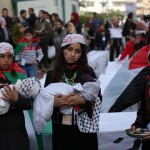 Palestinian children take part in a rally in solidarity with Palastinian refugees trapped in Syria's Yarmouk refugee camp in Jan 2014. Click to enlarge