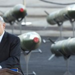 Prime Minister Benjamin Netanyahu speaks in Eilat on March 10, with the seized missile shipment behind him. Click to enlarge