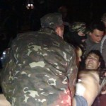 Pro Russian Ukrainians help a wounded comrade at the National Guard base in Mariupol, Thursday night. Click to enlarge