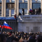 Pro-Russian activists with Russian national flags storm the Ukrainian regional office of the Security Service in Luhansk, Ukraine, Sunday, April 6, 2014. Click to enlarge