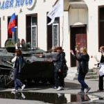 Residents in Slaviansk bring flowers to place them on armoured personnel carrier
