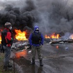 Pro-Russian protesters burn tires as they prepare for battle with the Berkut (Ukrainian special police forces) on the outskirts of the eastern Ukrainian city of Slavyansk on April 13, 2014. Click to enlarge