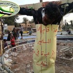 A man believed to have been crucified by fighters of the Islamic State of Iraq and Syria in the northern Syrian city of Raqqa. Click to enlarge